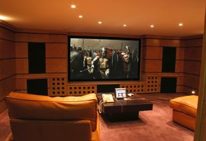 Basement cinema, fixed screen, front speakers flush fit.