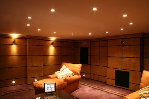 Basement Cinema, paneled room, seating and control panel