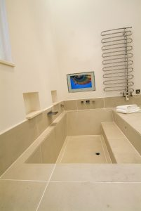 Bathroom with TV screen